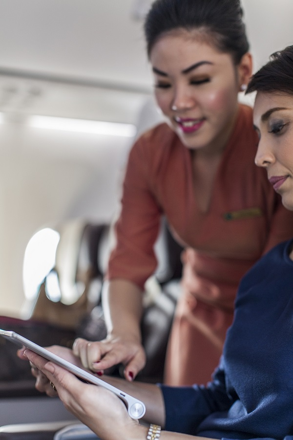 Business class passengers on flights longer than two hours receive complimentary tablet use.