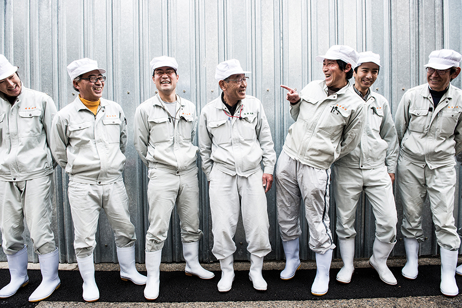 Workers at the Sohomare Sake brewery in landlocked Tochigi prefecture line up for a photo op.