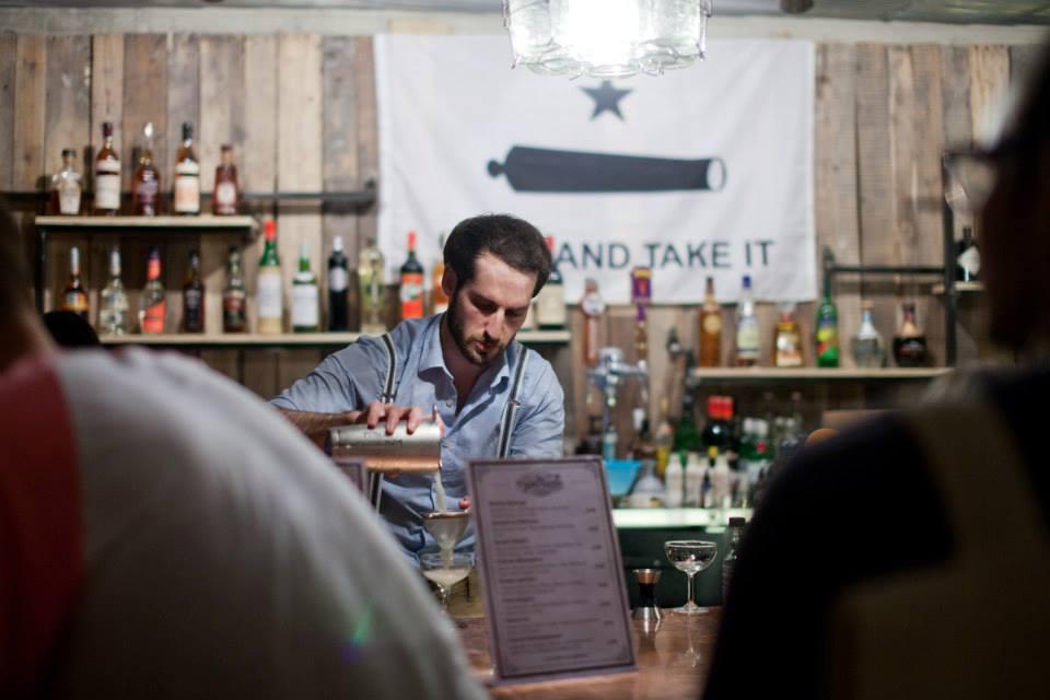 A bartender serving at Southside Parlor.