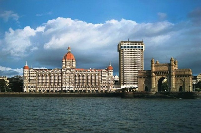Built on the Colaba waterfront, the Taj Mahal Palace hotel overlooks the imposing Gateway of India monument.