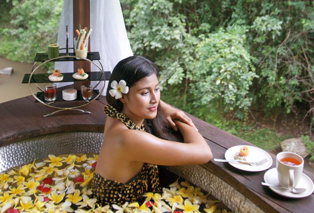 Enjoying a flower bath at Maya Ubud Resort & Spa.