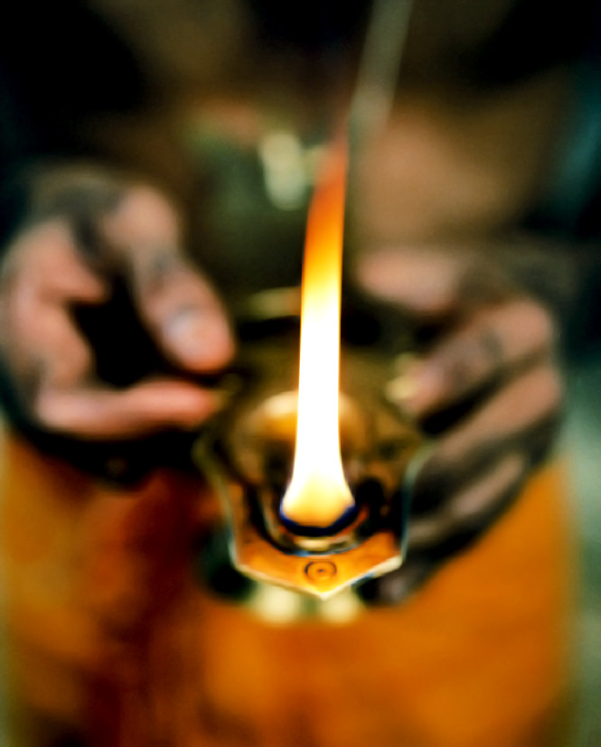 The flames of the puja candles burned at the resort represent pure consciousness.
