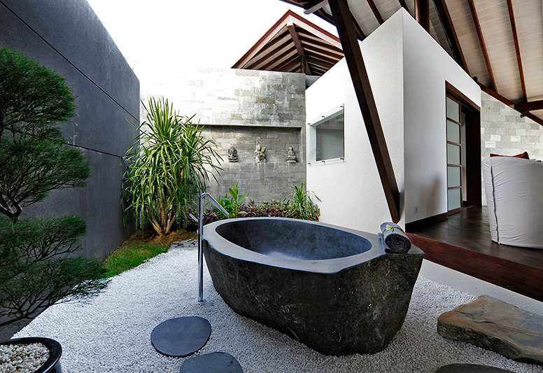 The one-bedroom villa boasts an outdoor bathtub.