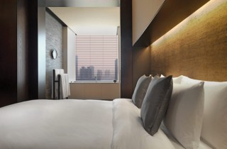 A Deluxe Suite bedroom at The PuLi.