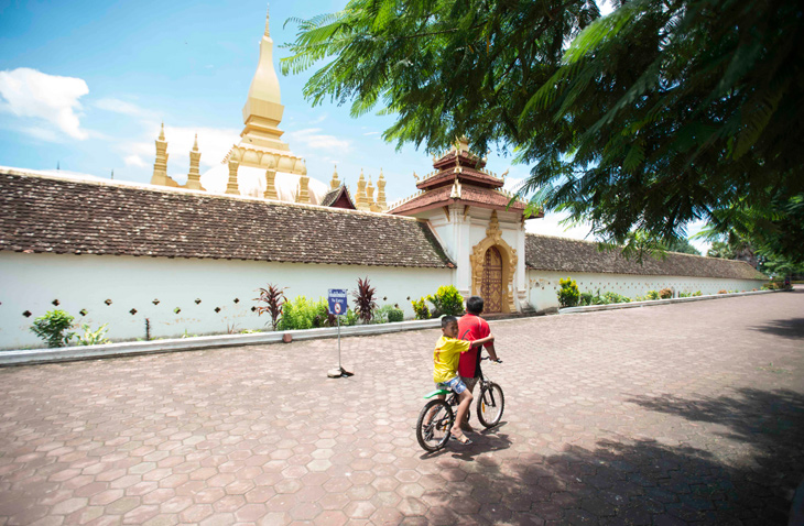 Outside the walls of Pha That Luang, Vientiane's iconic golden stupa.