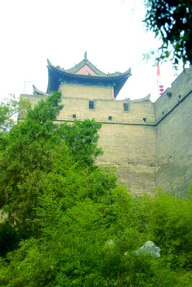 A tower rises above the battlements of Xian's old city wall.