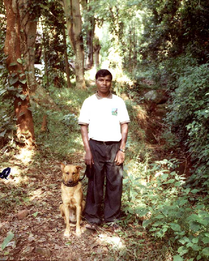 Kurumba Village Resort's Irula trail guide with his trusty tracking dog, Tiger.