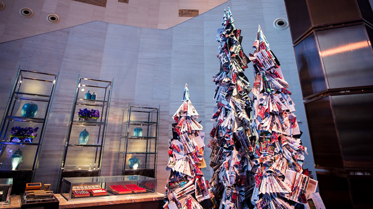 Christmas trees made out of outdated magazines.
