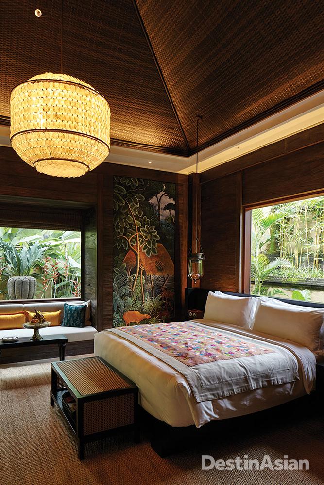 The bedroom of a riverside villa at Mandapa.