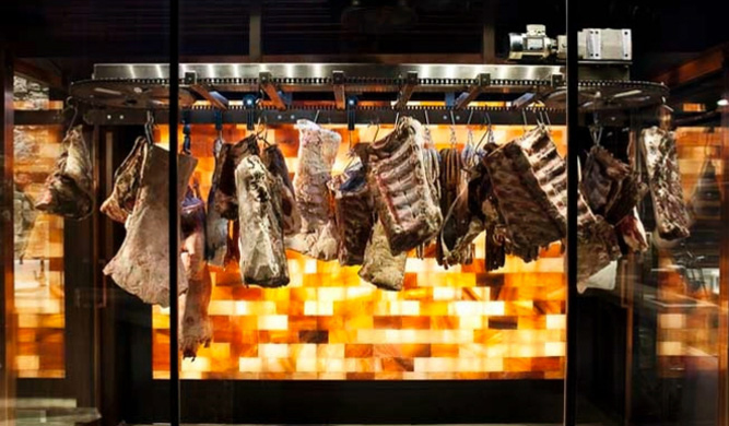 Hanging meats at Victor Churchill's butcher shop in Sydney.