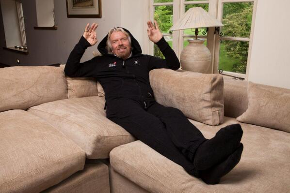 Virgin Atlantic CEO Richard Branson tries the onesie on for size.