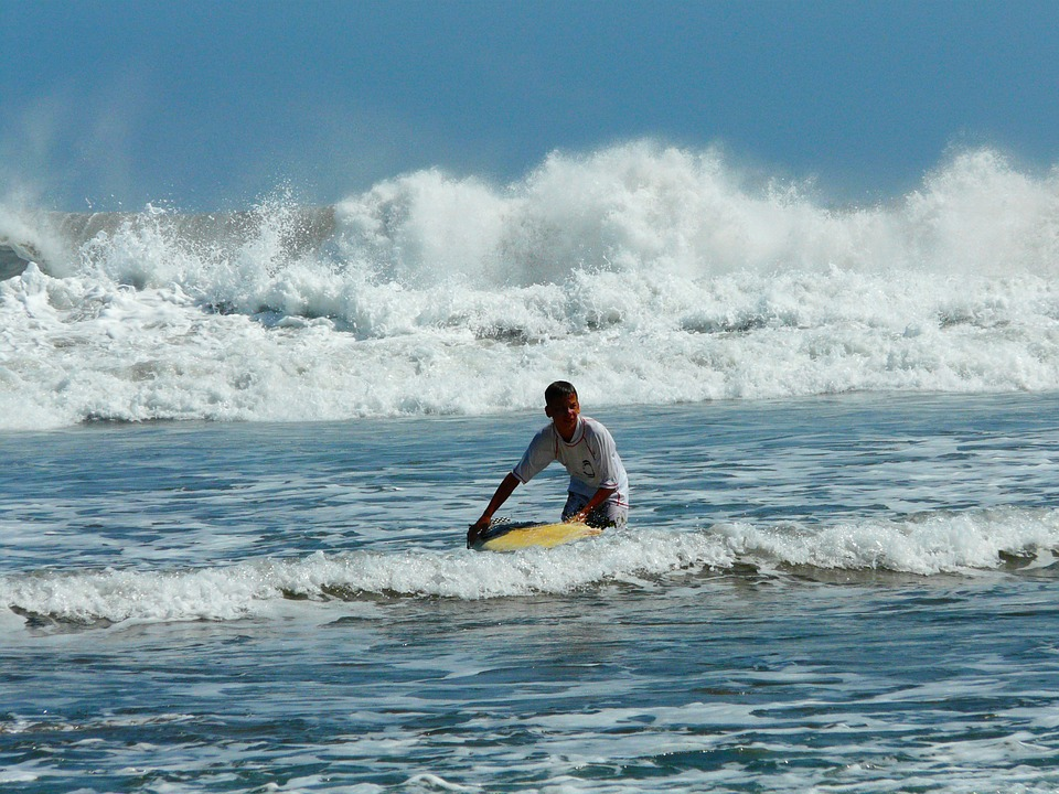 A surfer hitting the waves in Canggu.