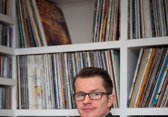 Founder of Music Concierege Rob Wood with his record collection.