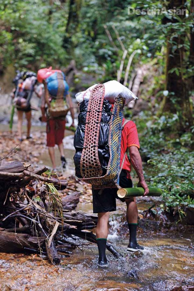 Iban porters heading into the jungle.