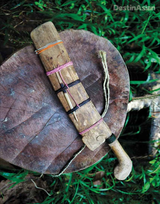 The wooden sheath of an Iban parang (machete), held together by natural twine and not-so-traditional cable ties.